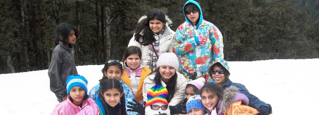 School Children making Snowman at Jalori Pass under heavy snowy conditions
